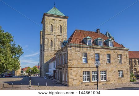 OSNABRUCK, GERMANY - AUGUST 25, 2016: Dom church on a cobblestoned street in Osnabruck, Germany