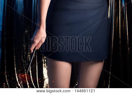 A Teenage Girl Magician With A Magic Wand , A Girl In A Skirt, The Slender Legs,