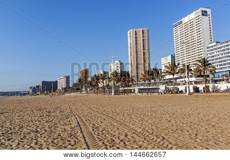 Empty Beach Against Golden Mile City Skyline