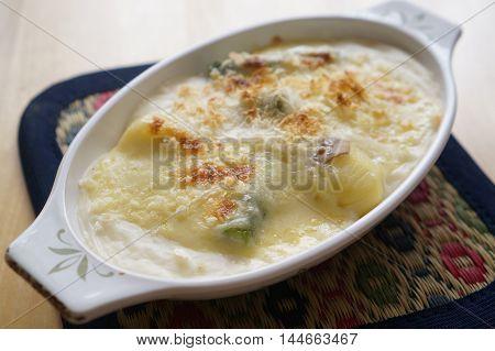 Hokkaido asparagus potato gratin on white bowl
