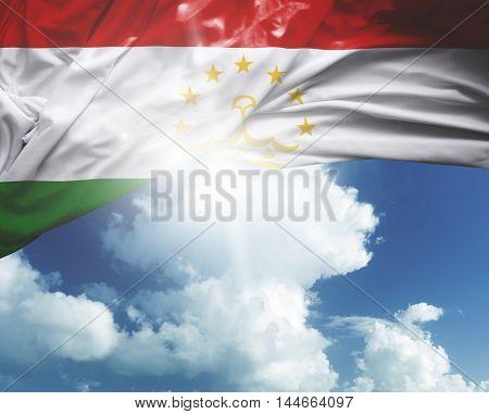 Tajikistan flag on a beautiful day