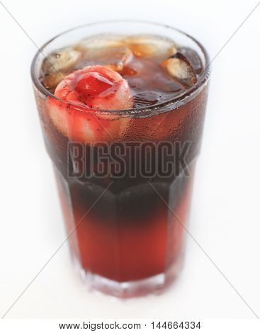 Spook Eyed Potion juice cocktail in glass with ice on white background