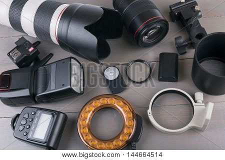 photo lenses and equipment on wooden background