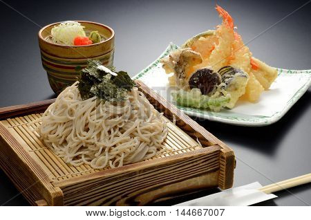 Japanese Udon noodle with seaweed and shrimp tempura on bamboo tray