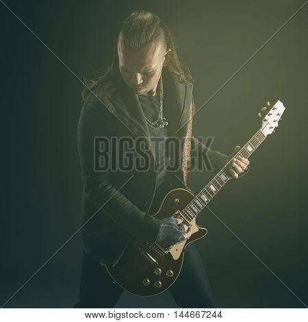 The Guitarist Plays Solo.