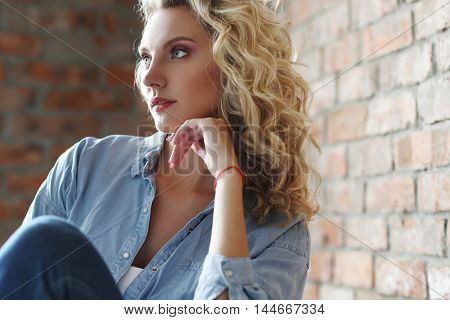 Lovely girl with blue eyes and curly hairstyle