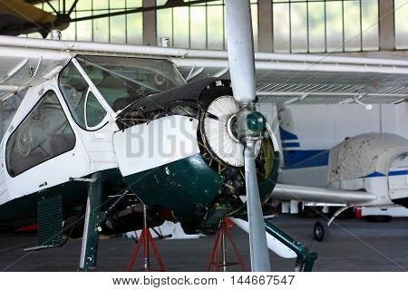 General prop aircraft motor maintenance in hangar
