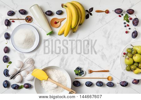 banana pie ingredients with berries on white background.