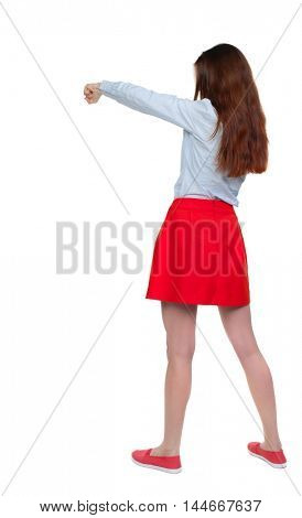 skinny woman funny fights waving his arms and legs. Long-haired brunette in red skirt boxing.