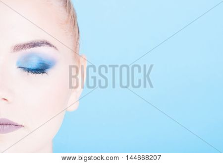 Half Face Close-up Of Beauty Make-up Portrait