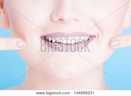 Close-up Girl Pointing Her Beautiful Smile With Lipstick