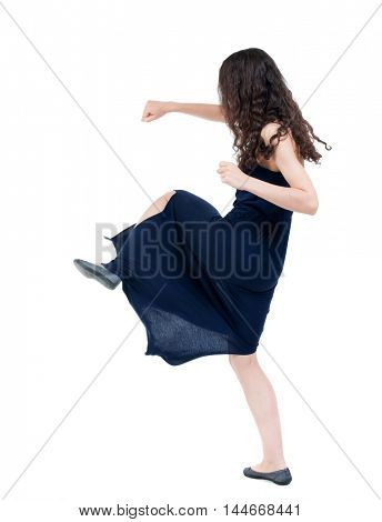 skinny woman funny fights waving his arms and legs. dark curly girl in blue evening dress fights.