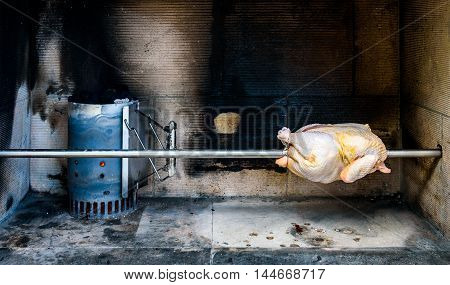 Cooking Rotisserie Chicken On The Grill With Charcoal And Briquettes