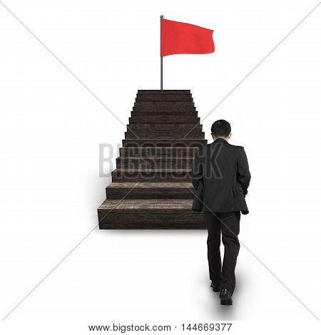 Man Walking Toward Red Wavy Flag On Top Of Stairs