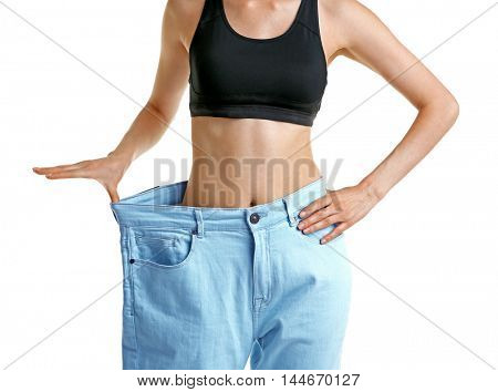 Girl in huge pants on white background