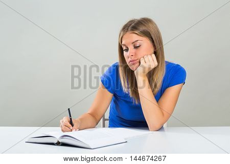 Sad female student doesn't want to study.