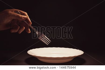 Male Hand Holding A Fork