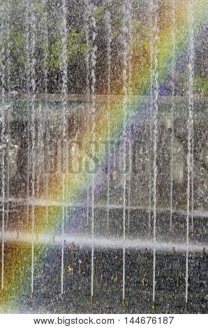 In fountain water streams fancifully the rainbow has appeared