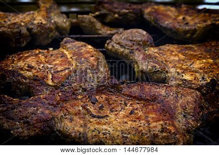 Delicious chuck steaks on the grill. Shallow depth of field.**Note blurriness best at small sizes.