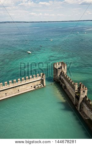 Backwater inside the Scaliger Castle - medieval port fortress Sirmione Italy