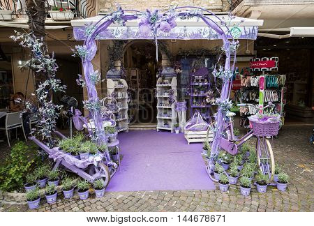 SIRMIONE ITALY - MAY 5 2016: Sirmione Italy. Show-window the shop of perfumery and spirits from a lavender. Italy takes the second place in the world on production of oil of a lavender