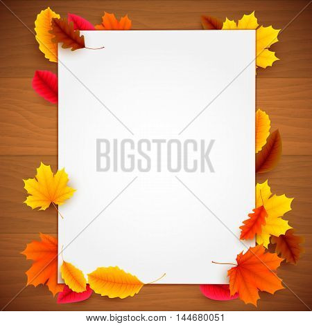 Blank white paper list and colorful autumn leaves on old wood background. Greeting or advertisment template