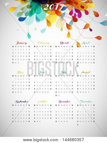 2017 calendar with abstract background with colorful leafs.
