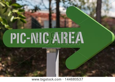 Picnic Area Arrow-shaped Sign: Green Symbol Outdoor  in Park