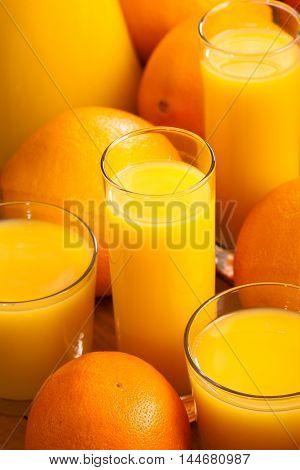 Glasses of orange juice vertical. Drink background