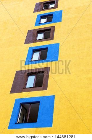 Windows on the facade of the yellow building