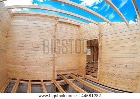 Construction of a new wooden house. Inside view