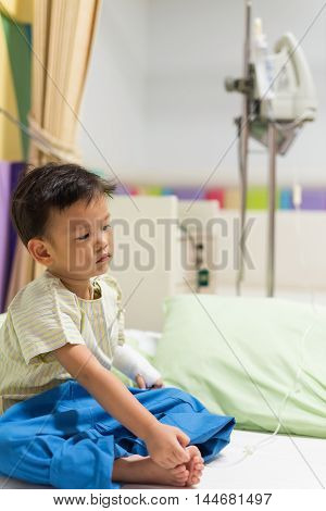 Asian Sick Boy With Iv Drip Needle