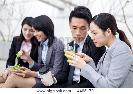 Business people having salad together