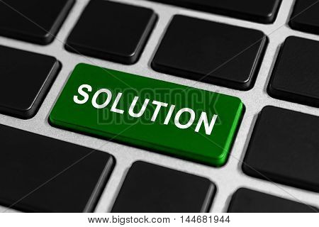 solution green button on keyboard business concept