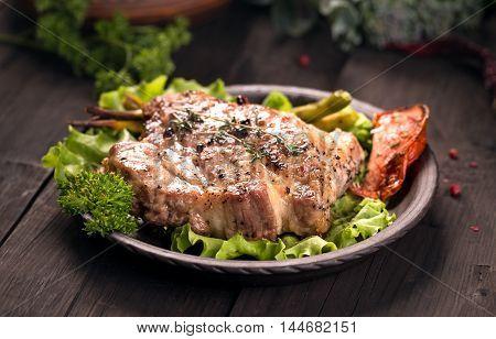 Grilled pork fillet meat on dark wooden background