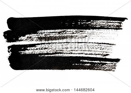 Expressive black brush strokes isolated over the white background