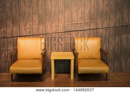 Leather Chair And Table With Wood Wall