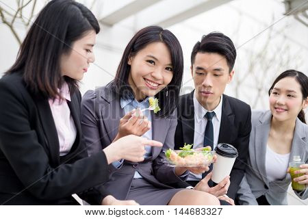 Group of business people having salad together