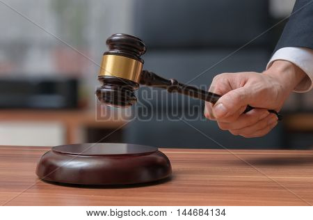 Lawyer holds gavel. Justice and Law concept.