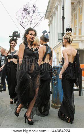 St. Petersburg, Russia - 12 August, Models on the street photo shoot,12 August, 2016. Girls model in designer dress posing on the street.