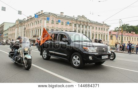 St. Petersburg, Russia - 13 August, The SUV with the flag of the sponsoring company,13 August, 2016. The annual International Motor Festival Harley Davidson in St. Petersburg.
