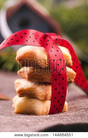 Homemade Christmas cookie with red ribbon closeup.Selective focus
