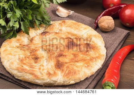 Homemade pita bread with vegetables and herbs