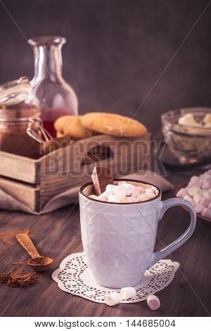 Mug of hot chocolate and marshmallow still-life. Toned
