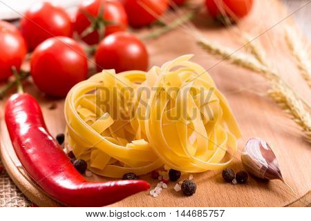 Italian fettuccine pasta with red cherry tomatoes and pepper