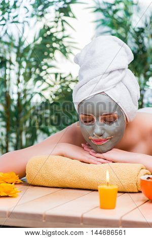 Young woman in spa health concept