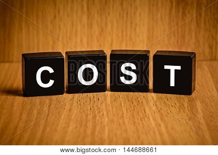 accounting cost text on black block, business concept