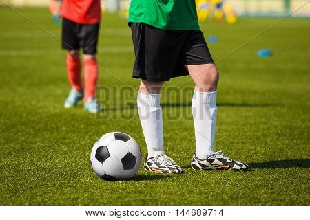 Young soccer football player standing on the soccer field