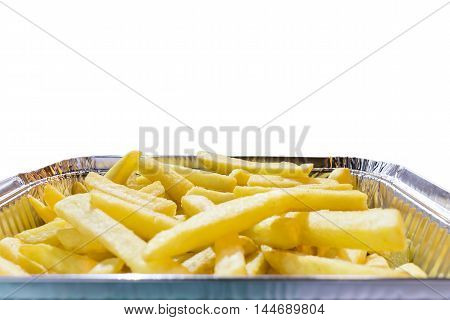 fried potato in aluminum pan on white background
