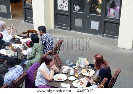Covent Garden London England United Kingdom - August 16 2016: People enjoying meal at Covent Garden Restaurant